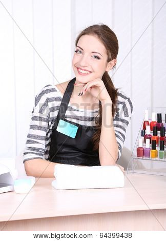 Beautiful girl manicurist in beauty salon