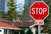 stock photo of octagon shape  - Stop road sign all way in the city - JPG