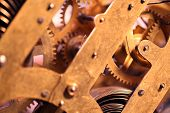 stock photo of wind up clock  - Close up of an internal clock mechanism