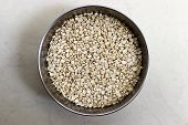 stock photo of urad  - closeup of dry white split lentil also called as urad dal in India - JPG