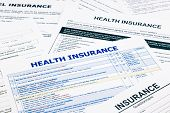 pic of insurance-policy  - health insurance form paperwork and questionnaire for insurance concepts - JPG