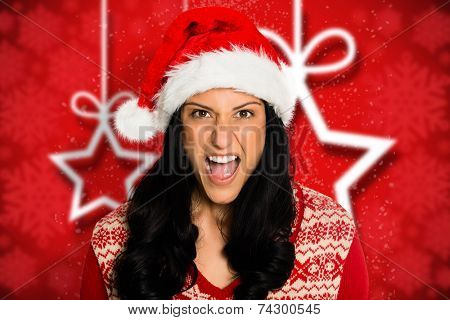 Irritated woman looking at camera against blurred christmas background