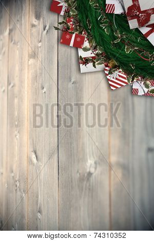Festive christmas wreath with decorations against bleached wooden planks background