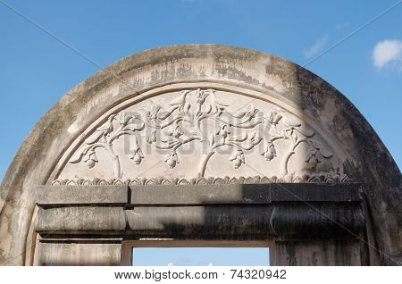 bas relief at the top of gate in pulo cemeti taman sari water castle - the royal garden of sultanate
