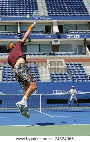 Grand Slam Champion Lleyton Hewitt and professional tennis player Tomas Berdych practice for US Open