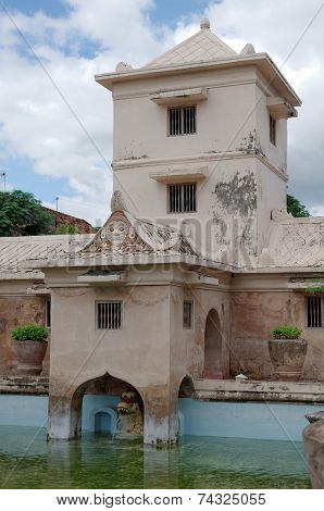 tower over the ancient pool at taman sari water castle - the royal garden of sultanate of jogjakarta