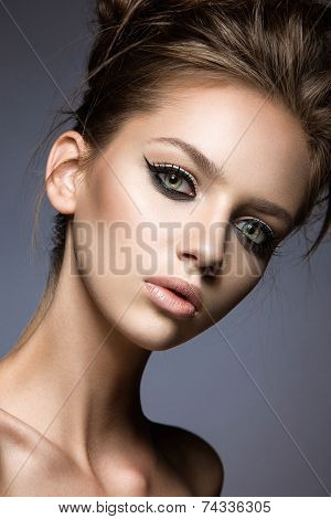 Beautiful girl with long eyelashes and perfect skin.