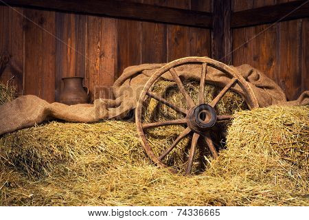 Interior Of A Rural Farm - Hay, Wheel, Pitcher.
