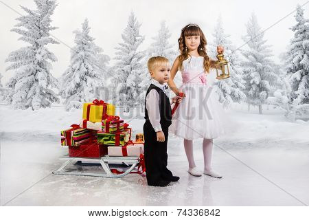 Children Carry A Heap Of Gifts On A Sledge.