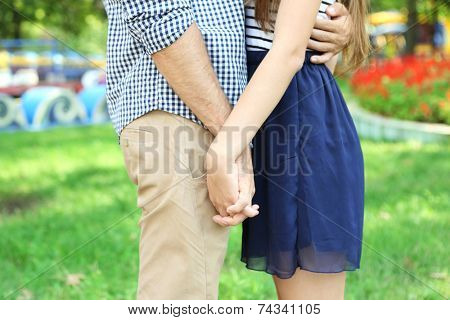 Embrace a loving couple outdoors