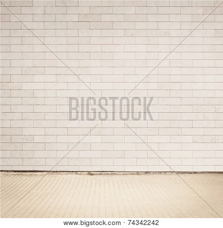 Light grey brick wall texture with walkway.
