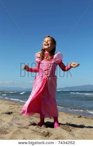 Happy princess on a beach