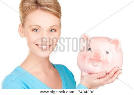 Lovely Woman With Piggy Bank