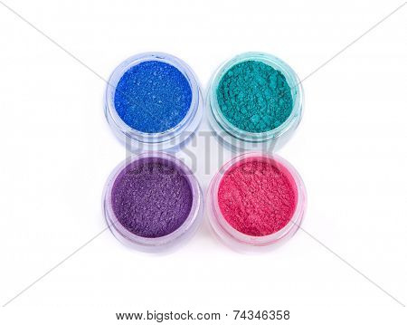 Set of mineral eye shadows in pastel colors, top view isolated on white background