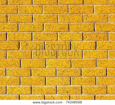 The Yellow Brick Wall Texture And Little Black Spot, Use As Background.