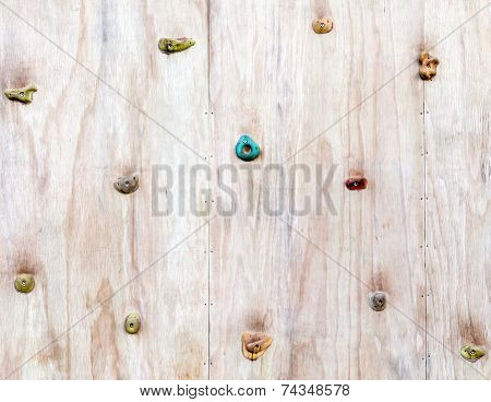 The Wood Surface Of An Artificial Rock Climbing Wall With Hand And Toe Hold Studs.