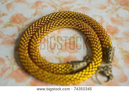 Knitted Necklace From Transparent Yellow Beads