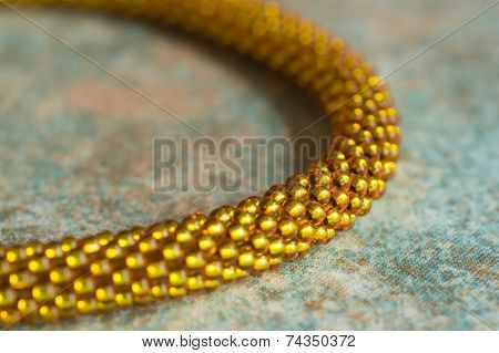 Necklace Fragment From Beads On A Textile Background Close Up