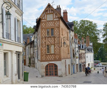ORLEANS, FRANCE - SEPTEMBER 10, 2013: People on a narrow street in historical center of city. Orleans belongs to the Loire Valley sector, which was in 2000 inscribed by UNESCO as a World Heritage Site