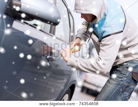 transportation, crime, people and burglary concept - thief breaking car lock screwdriver