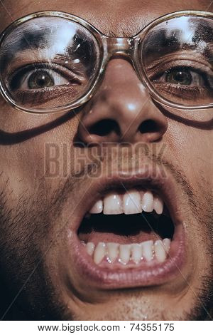 Angry Screaming Man In Glasses
