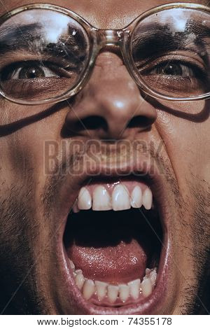 Angry Screaming Man In Old Glasses