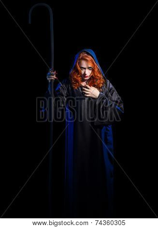 Young witch with staff isolated