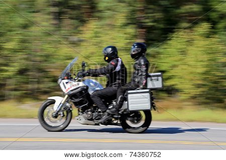 Two Bikers Riding A Motorcycle, Motion Blur
