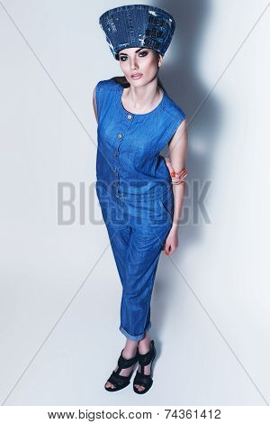 Fashionable Woman In Denim Hat And Jumpsuit