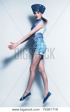 Jumping Woman In Blue Denim Shorts And Waistcoat