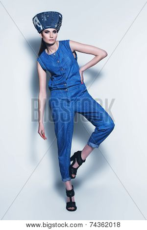 Posing Woman In Denim Hat And Jumpsuit
