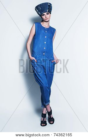 Serious Woman In Denim Hat And Jumpsuit