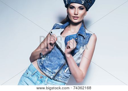 Sexy Woman In Blue Denim Waistcoat And Hat