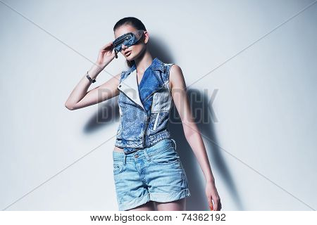 Sexy Woman In Denim Waistcoat And Sunglasses