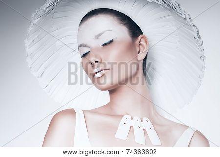 Portrait Of Woman In Paper Hat