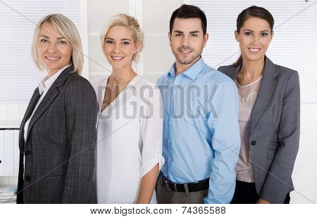 Portrait: female boss with her staff. Sucessful teamwork.