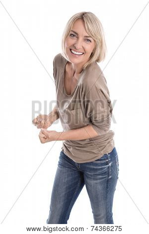 Cheering happy older isolated blond woman in blue jeans and white teeth.