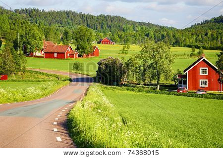 old red farm houses set in a rural landscape and nature