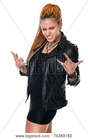 Young Girl In Leather Jacket With Dreadlocks With Characteristic Heavy Metal Hand Gesture.