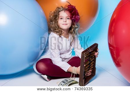 Girl Schoolgirl With Wooden Abacus And A Wad Of Dollars.
