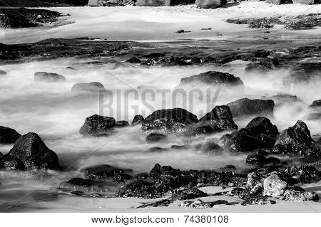 Black and White Photos of Rocks on a Beach