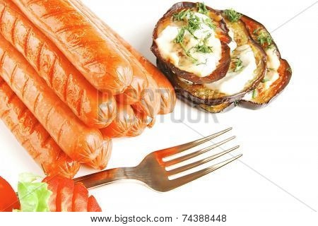 sausages served on white background with vegetables