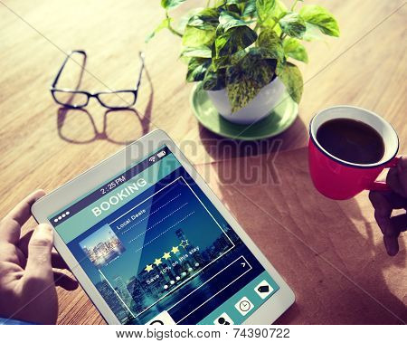 Man Booking Hotel Reservation on Digital Tablet