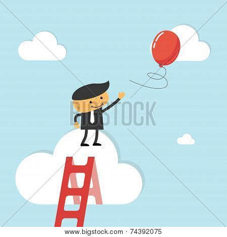 Businessman reach out for balloon