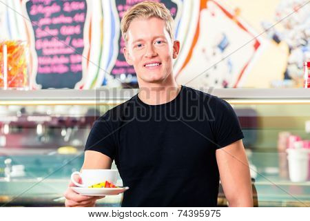 Waiter working in ice cream parlor or cafe serving coffee