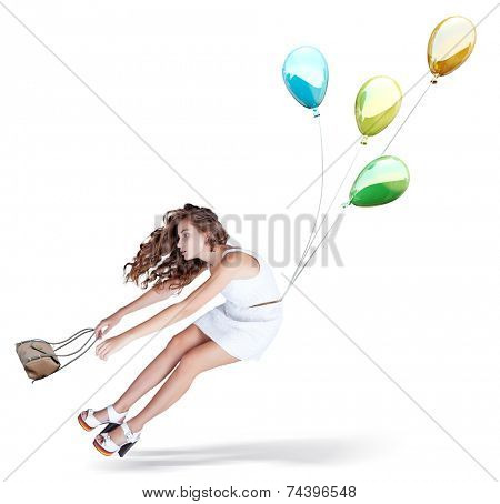 Balloons fly with young beautiful girl. Isolated Creative concept