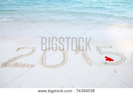 Numbers 2015 on tropical beach sand