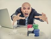 image of spanish money  - desperate addict businessman on computer laptop loosing lots of money betting on internet poker with cards and chips on online gambling addiction isolated - JPG