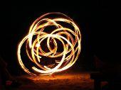 image of juggler  - Fire Juggler In Full Swing on a beach in Krabi Thailand - JPG