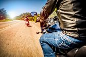 stock photo of motorcycle  - Bikers driving a motorcycle rides along the asphalt road  - JPG